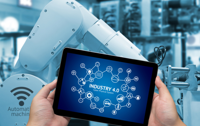 Industry 4.0 concept .Man hand holding tablet with Infographic Industry4.0 icons screen and blue tone of automate wireless Robot arm in smart factory background